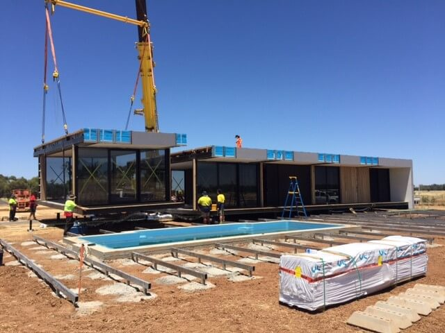 Modular home being installed on remote property