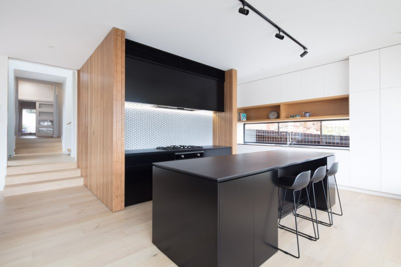 Black and timber kitchen of modular home