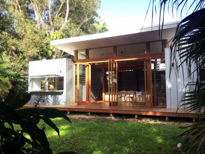 Hidden view from plants outside modular home with decking