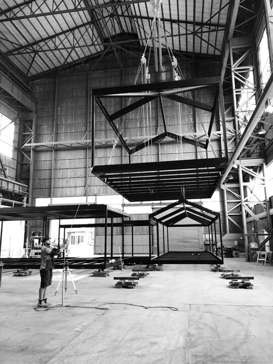 Modular home frame being elevated in Modscape factory