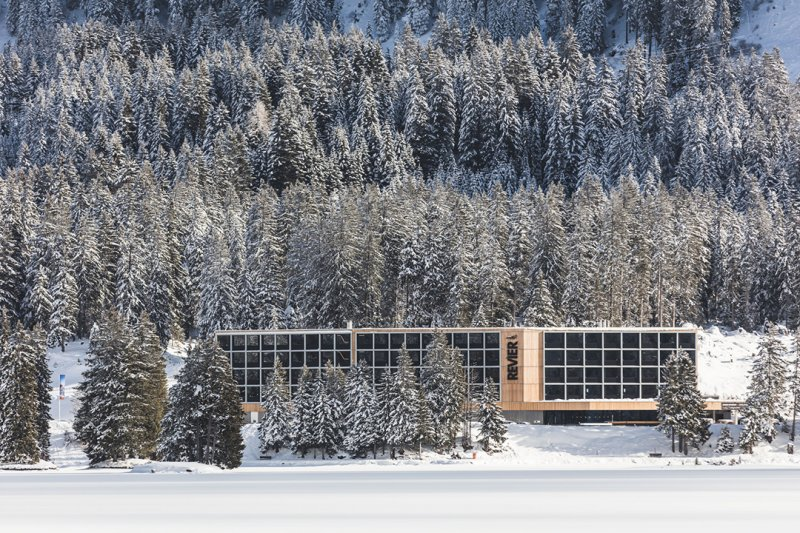 Hotel Revier sitting amongst snow-capped fir trees